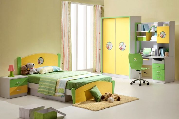 cozy green yellow kids bedroom furniture with cabinet and study table beside the window featuring fur rug in front of the bed 800x533 | Kids Bedroom Decorating Ideas with Modern Furniture