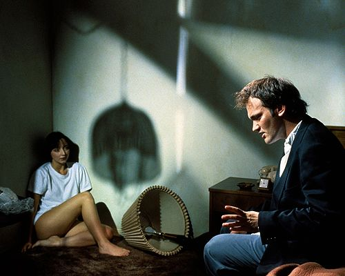 Behind the scenes photo from Pulp Fiction (1994) showing Quentin Tarantino directing Maria de Medeiros as her character Fabienne, girlfriend of Butch Coolidge (Bruce Willis).
