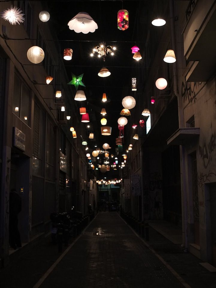 Installation of different lamps on a street in Greece.