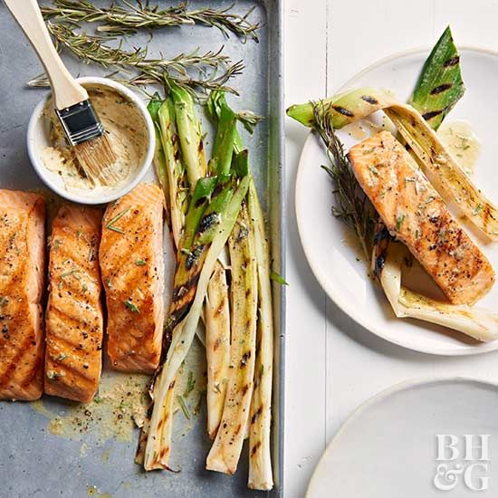The key to this grilled salmon dinner? A rich rosemary-mustard butter. Slather it over the hot food and watch it melt into a velvety sauce.