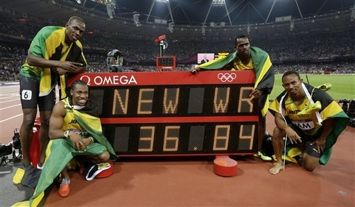 From left, Jamaica's Usain Bolt, Jamaica's Yohan Blake, Jamaica's Nesta Carter and Jamaica's Michael Frater pose next to timing board displaying their world record time of 36.84 seconds for the men's 4x100-meter relay