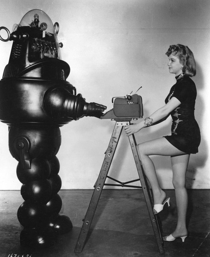 Anne Francis and Robby the Robot in photo for Forbidden Planet (1956)