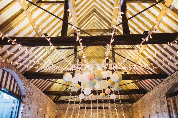 Pastel Hanging Lanterns and Pom Poms at Barn Wedding by Oakwood Events #Lighting #MonksBarn #lanternlove