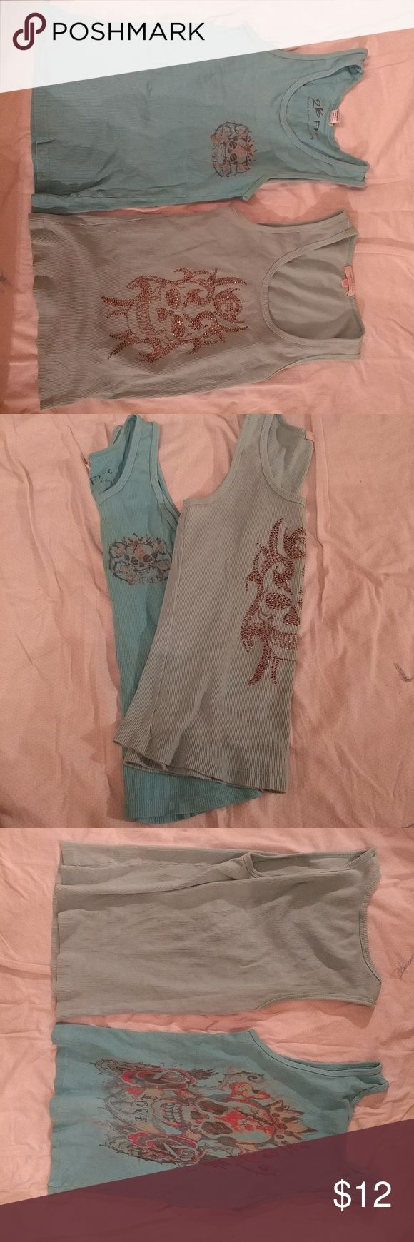 Lot of 2 Skull tanks Calling all rock and roll lovers!! This listing is for 2 wife beater style tanks. Both are from higher end designer brands. Both are shorter style (not as short as crop tops tho) cute for that rocker look. Both are bluish/mint color. Rhinestone skull tank is from Romeo & Juilet Couture. Floral Skull design is from 2B Free. Both size Medium but both fit like a small. Worn and washed amd show minor signs from that. Neither r have major damages or stains. From high end…