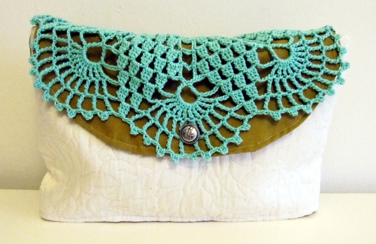 Clutch bag, combining turquoise crocheted clotch with poison green cotton. (May 2012)