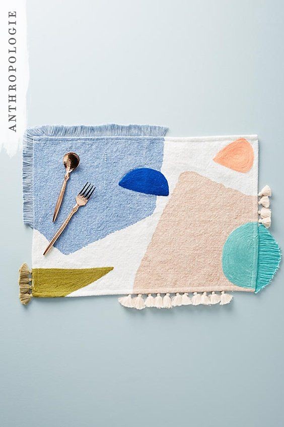 DIY Inspiration Placemats | This Franni placemat is perfect for lovers of bold colour and pattern. It's crafted from screen-printed cotton that's embroidered with geometric shapes in soft pastel shades and features tactile fringing, as well as tassel pompoms, for a whimsical finish - perfect for bringing a touch of fun to your dinner party.