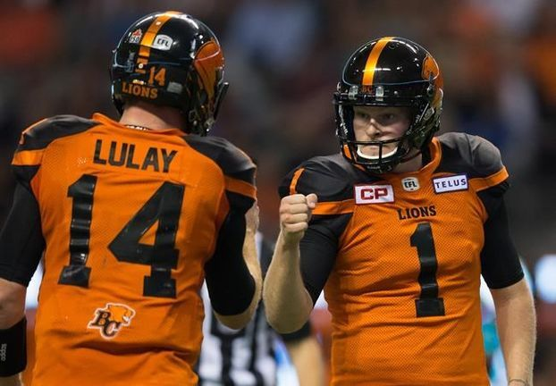 Week 5: July 21 2017 - Wpg. 42 - BC 45 - B.C. Lions' Ty Long, right, and quarterback Travis Lulay celebrate after Long kicked what proved to be the winning field...