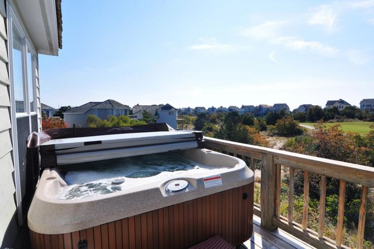 L23: On The Sunny Side | Nags Head Rentals | Village Realty. 3 bedrooms, 2 baths. hot tub on the upper sun deck, WiFi,  TVs, Blu-Rayplayer and  DVD players.  Community features include two soundside piers for taking in gorgeous summer sunsets over the water.