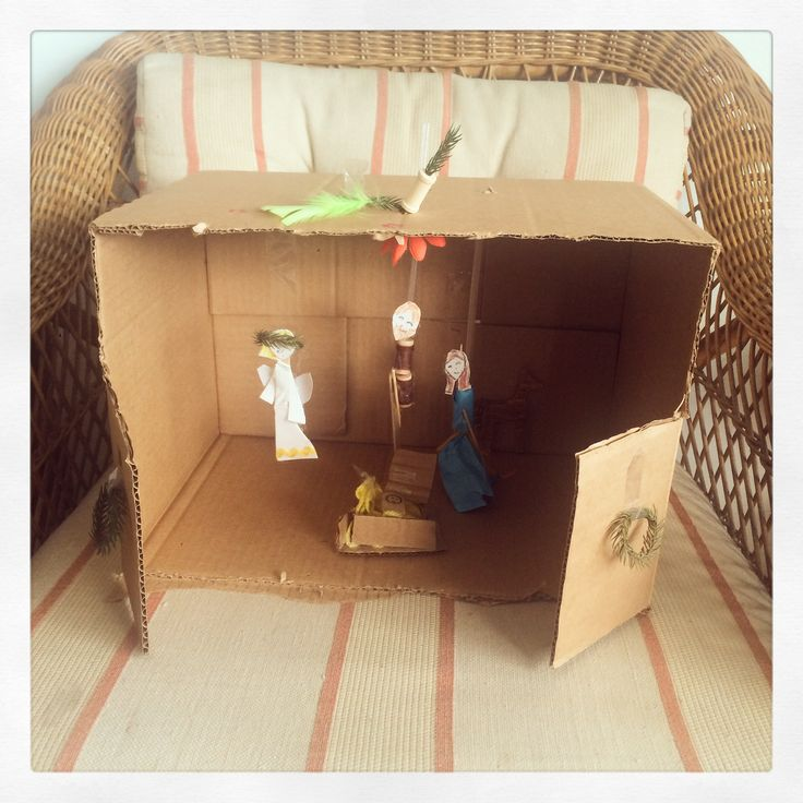 Nacimiento II-Cardbox, paper, scissors, Uhu and scotch tape (9yrs. old)