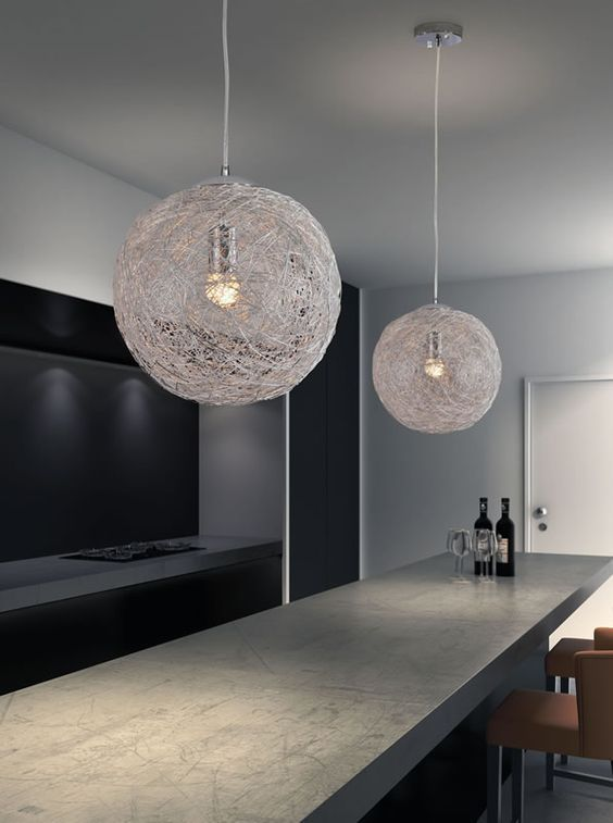 The Opulence lamp's aluminum mesh shade envelopes the bulb creating a warm halo of light   #interiordesign #furnituresale #homedecor #midcentury