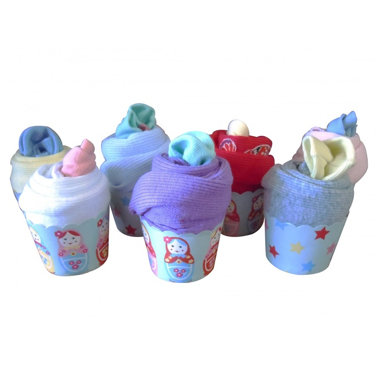 Cotton Singlet and Sox Cupcakes - Set of 3 $69 (AUD).  This cute little cupcake holds a cotton singlet and cotton socks. A cute wee gift for a little baby. Available in different sizes.