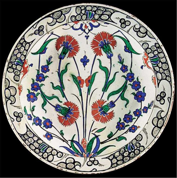 Iznik Tile: An Iznik Carnations and Prunus blossom Polychrome Dish C 1575 Lot 17