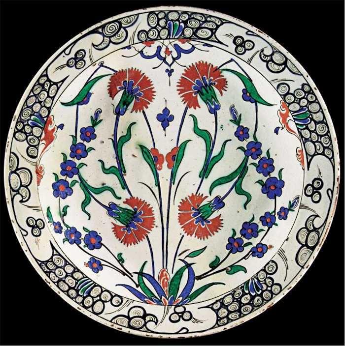 Iznik Tile: An Iznik Carnations and Prunus blossom Polychrome Dish C 1575 Lot 17
