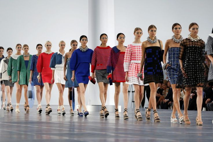 Models present creations by German designer Karl Lagerfeld for French fashion house Chanel as part of his Spring/Summer 2013 women's ready-to-wear fashion show during Paris fashion week