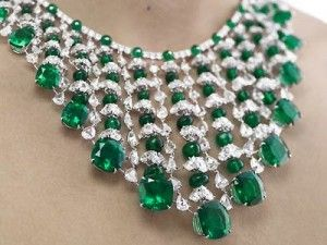"""Beautiful $3 million Chopard Diamond and Emerald Necklace is one of the most eye catching necklaces.  Any woman wearing this necklace will spontaneously be nicknamed """"green lady"""" because of its huge green Colombian emeralds weighing nearly 191 carats! The necklace is made of 16 carats of diamonds that are attached to an excellent symmetry with green Colombian emeralds."""