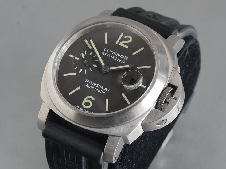 Panerai Luminor Marina Pam240 braun Tabacco Dial LC100Reference: PAM 240Mechanism: AutomatikCase: TitaniumStrap: Crocodile skinClasp: Buckle / TitaniumVery Good Condition 1Year: 2007With Box and documentsGlass: SapphireDiameter: 44 mm12 months warrantyserviced 8/2015Small Seconds, Luminescent Numerals, Luminescent Hands, Chronometer, Limited Edition, Screw-Down Crown