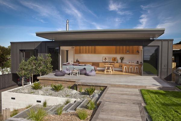 modern holiday home in new zealand screened by pohutukawa