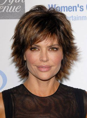 To get Lisa Rinna's hairstyle, add root lift and blow-dry your hair with a round brush for volume on top. Kick the ends out by bending with a flat iron, then tuck the sides neatly behind your ears.