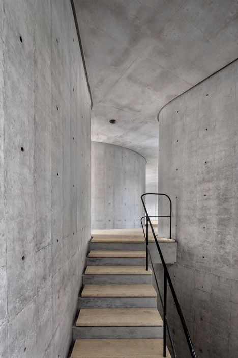 The staircase inside a concrete Mexican house.