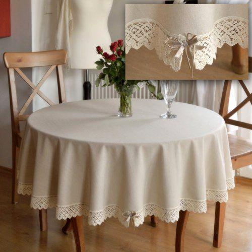 Obrus okrągły lniany beżowy. Len naturalny z domieszką bawełny z bardzo delikatnym deseniem w paski. Obrus zdobiony koronką o szerokości 5 cm w kolorze ecru i tasiemką szutasz.