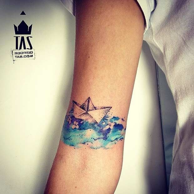 Origami boat on watercolor water   51 Watercolor Tattoo Ideas for Women