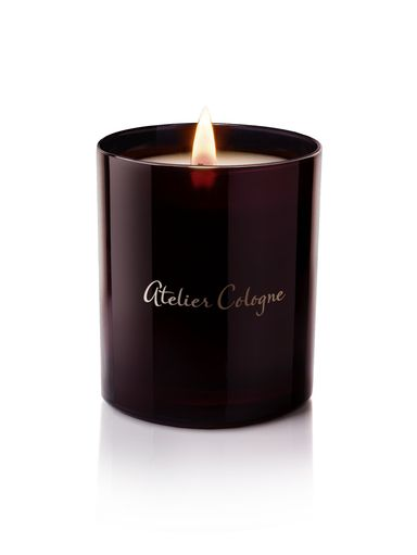 Atelier Cologne: Ambre Nue - Candle  - Ambre Nue, a fortuitous encounter of fresh green mandarin with nigritella rubra, an elusive orchid with hints of jasmine, and earthy, musty-sweet resins of benzoin mixed with spicy cistus labdanum and sweet tonka bean.   Each Atelier Cologne candle begins with the highest percentage of fragrance oils combined with a custom blend of vegetable and paraffin waxes. Every scent requires a specific composition of waxes to capture the essence of the Cologne…