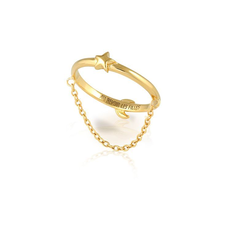 Star Moon Reversible Ring. SHOP NOW by clicking on website.The crescent and star encircle each other in a golden arc, featuring a fine gold chain that drapes beautifully across the finger and catching the light as one moves. Wear in 4 different ways, with the star or moon on top, with the chain above or under the finger. CLICK to SHOP