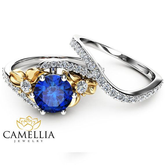 Check this sapphire unique engagement ring set from Camellia Jewelry. Scrupulously handmade in fine detail, it is a unique two tone gold ring set that will show her how much you care without breaking the bank. It has been meticulously handcrafted by a team of seasoned artisans in the heart of Israel. The engagement ring features an half eternity 14K white and yellow gold mounting that beautifully caresses the sparkling blue sapphire focal. A matching diamond encrusted wedding band…