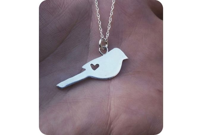Love bird pendant  by Secrets Unearthed Jewellery