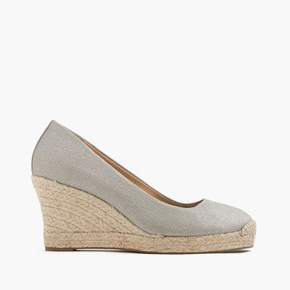 "Wedges: how to do heels without the heel. We made this pair in a special canvas with a hint of metallic shimmer, so they're even more irresistible than usual. <ul><li>3 3/4"" jute heel with an exterior platform for extra comfort.</li><li>Canvas upper.</li><li>Leather lining.</li><li>Import.</li></ul>"