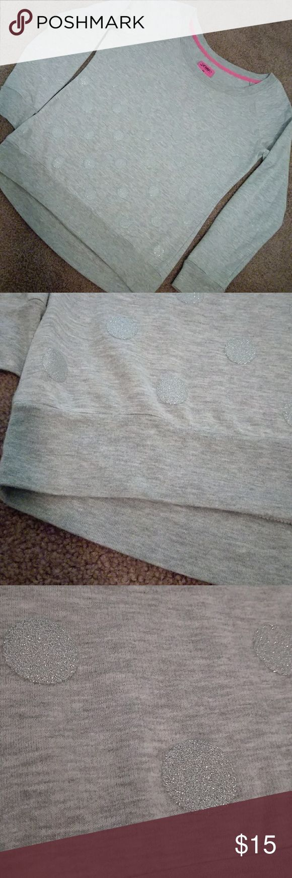 JENNI BY JENNIFER MOORE SWEATSHIRT WITH SHIMMER Great condition gray sweatshirt with shimmer sparkly circles on front only. This is super soft. Banded waist and cuffs. Machine wash. Ladies size medium. Bundle with other items for even more savings! Jenni Tops Sweatshirts & Hoodies