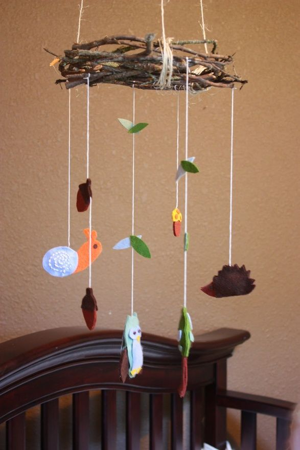 I have a woodland nursery mobile similar to this.  I like the idea od the wreath rhat the animal's hang from. Hmmmm.