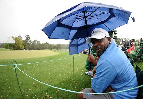 Emmitt Smith Photos Photos - NFL legend Emmitt Smith watches the play during the first round of the 2010 Masters Tournament at Augusta National Golf Club on April 8, 2010 in Augusta, Georgia. - The Masters - Round One