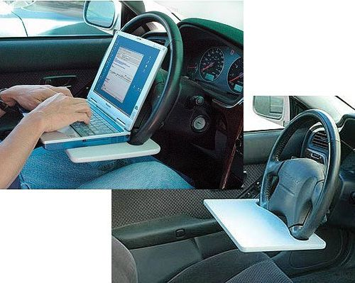 Steering Wheel Laptop Desk - Not while driving, of course. But I could see home health nurses loving this.