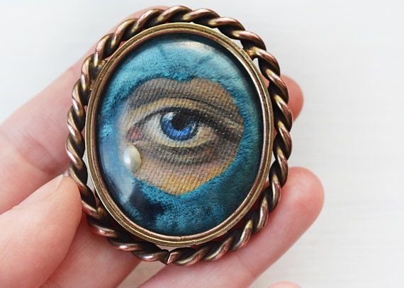 This is a very unique antique pin with hand painted lovers eye (or eye of Virgin Mary) with split pearl tear and velvet heart shape sorrounding. Twist wire heavy large statement brooch. The pin is made by THERALL ltd. Was sold as antique, but I didnt find anything about the company. Pins