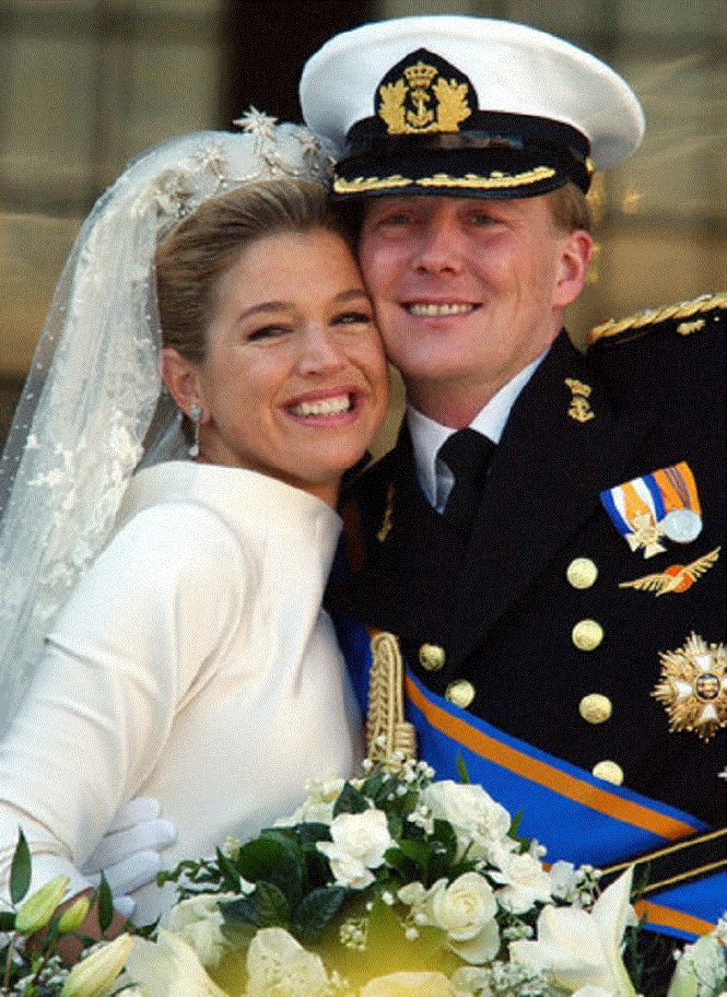 Dutch Crownprince Willem Alexander and his wife Princess Maxima Zorreguieta on the balcony of the Royal Palace in Amsterdam