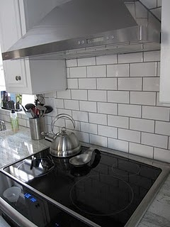 white kitchen - subway tile with dark grout