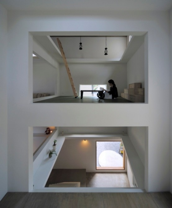 Ultra Minimalist And Thin House With Ladders Connecting Stories
