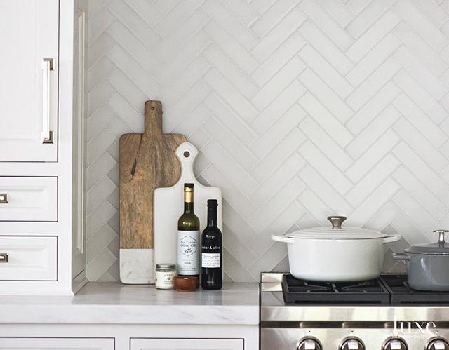 Matte glass herringbone tiles make for a beautiful backsplash #TileTuesday #InstaLuxe #LuxeNY July/August Interiors: @morganharrisonhome Architecture: Michael Smith Photo: @janebeilesphoto