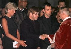 July 22, 1997: Diana, Princess of Wales, sits next to pop-star Elton John and David, his partner during a Memorial Service for Italian stylist Gianni Versace in the Milan Cathedral.