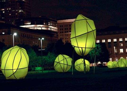 wire sculptures wrapped in solar fabric, collects energy from the sun during the day and lights up at night
