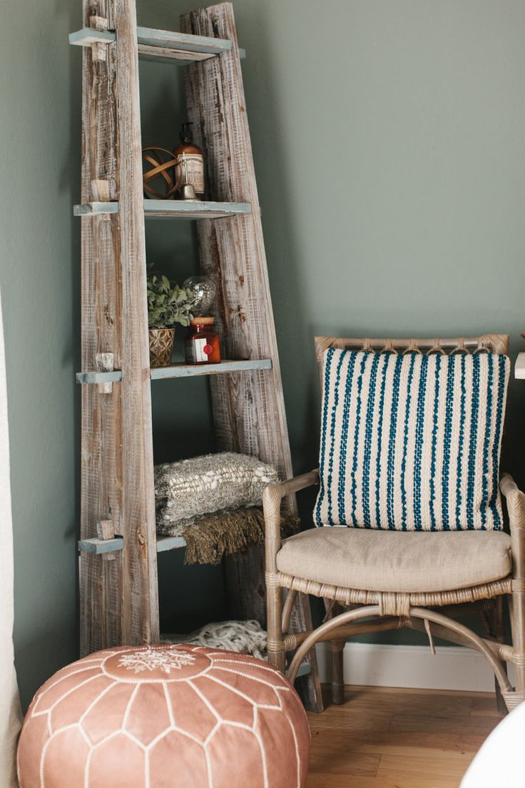 rustic blanket ladder with rattan chair and leather Moroccan pouf