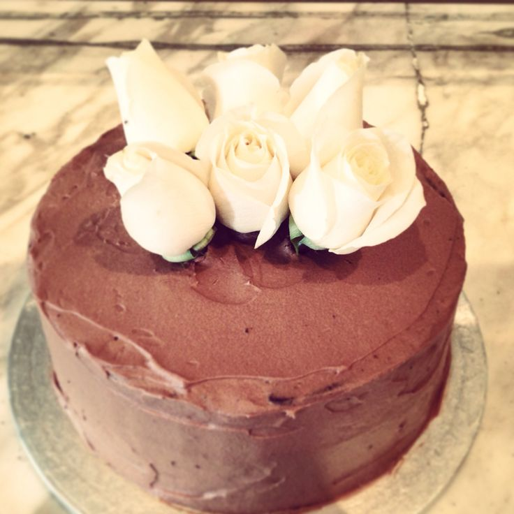 Birthday cake for my mum's 60th. Chocolate mud cake covered in ganache and decorated with fresh roses.