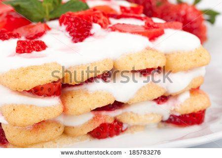 Italian Cuisine - Desserts - Closeup shot of strawberries tiramisu. - stock photo