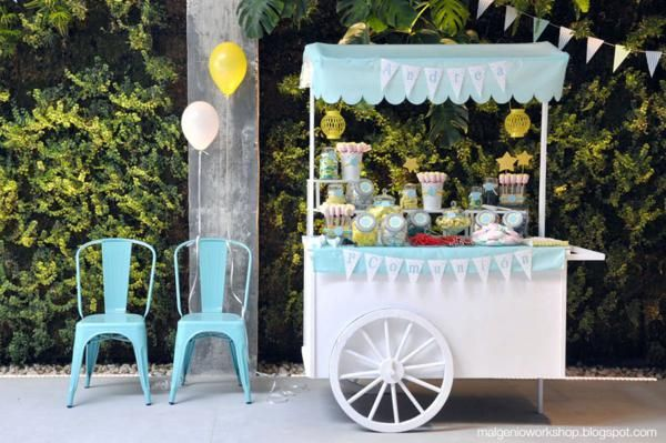 Going to paint the tea cart like this, ad some poles and fabric and oi la! Ice cream cart.