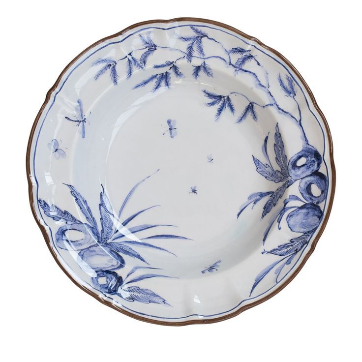 Deep plate in smooth white ceramic entirely handcrafted by the artisan of Milanese Laboratorio Paravicini. The piece is hand-painted with a blue rococo design and finished with a dark rim. As the plate is decorated by hand, each piece is a one-off and may vary slightly.