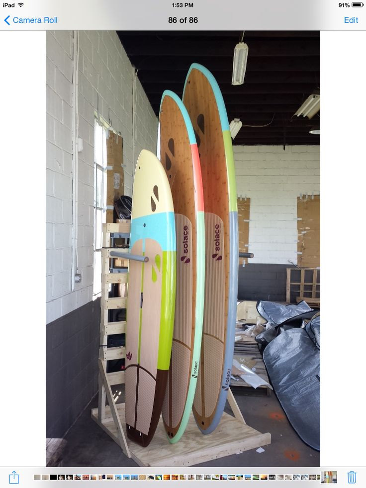 Custom wood pallet paddle board rack completed for displaying our goodies! A few of our Solace SUP models