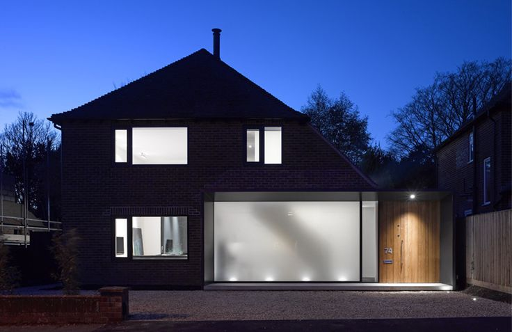 long-house- Same image at night, great use of lighting and glass on modern extension to give inviting, welcoming feel.