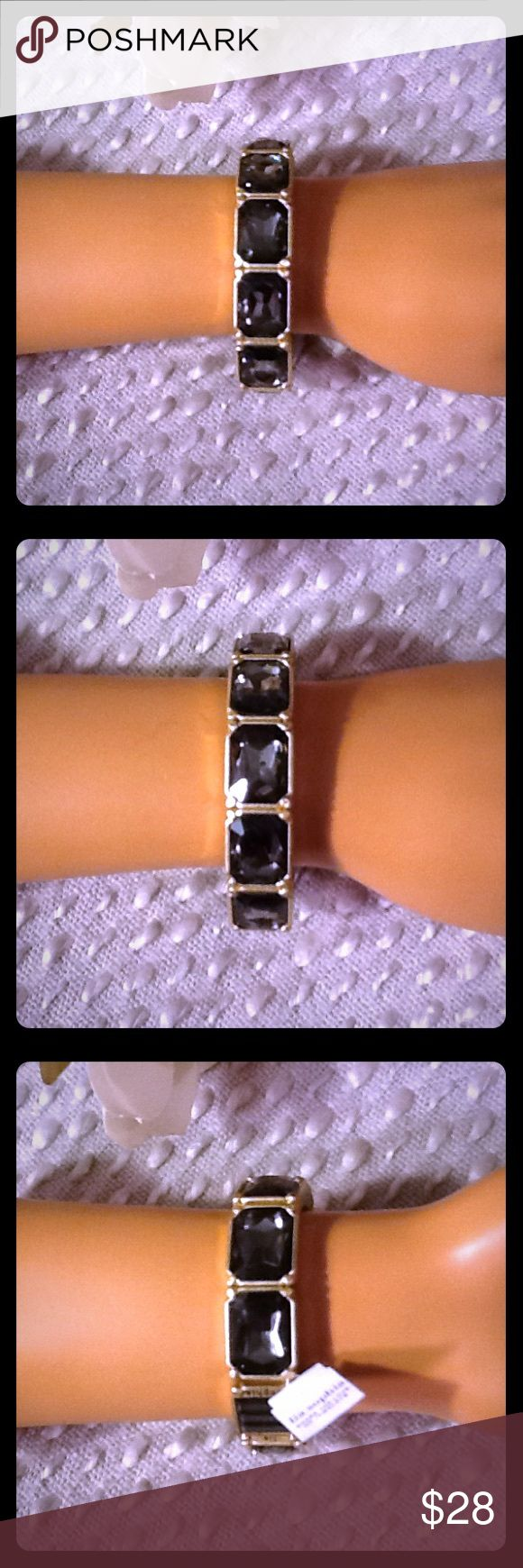 Lia Sophia Stretch Bracelet NWT Charcoal Gray Gems Beautiful Lia Sophia stretch bracelet, NWT, gemstones are charcoal gray colored, band is metallic gold, should stretch to fit most wrist sizes. Bundle to save 15% off your purchase of 2 or more items from my closet! Lia Sophia Jewelry Bracelets