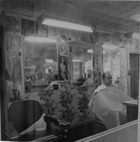 Diane Arbus, Pin-up Collection at a Barber Shop, NYC, 1963